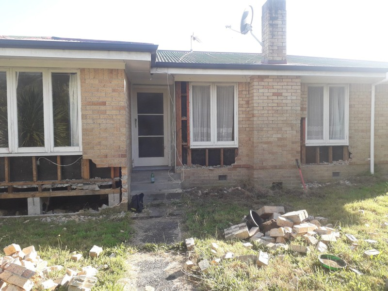 RELOCATED AND PILED 3 BEDROOM EX BRICK HOUSE