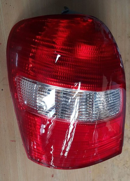 NEW Mazda Familia Tail Light 99 Hatch 1287 RH OR LH