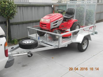 RIDE ON MOWER PICKUP AND DELIVERY SERVICE.