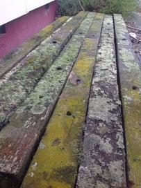 Rustic hardwood crossarms/sleepers and insulators